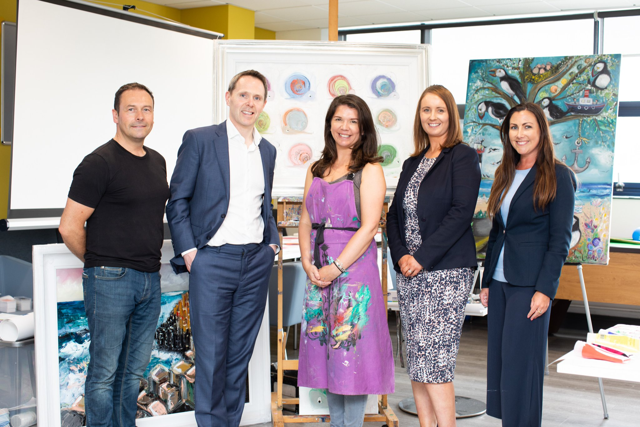 Artist Stephen Whalley; Michael Neil, Head of Belfast Office, ALG; Artist Dawn Crothers; Jill Michael, HR Lead, ALG Belfast; and Glenda McStravick, Marketing Manager, ALG Belfast
