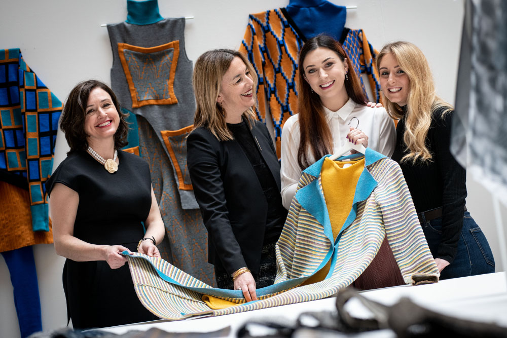 Carson McDowell senior partner Neasa Quigley; Professor Raffi Folli, Provost of Ulster University's Belfast/Jordanstown campus; and final year Textile Art, Design and Fashion students Jennifer Heslip and Katrina Reynolds
